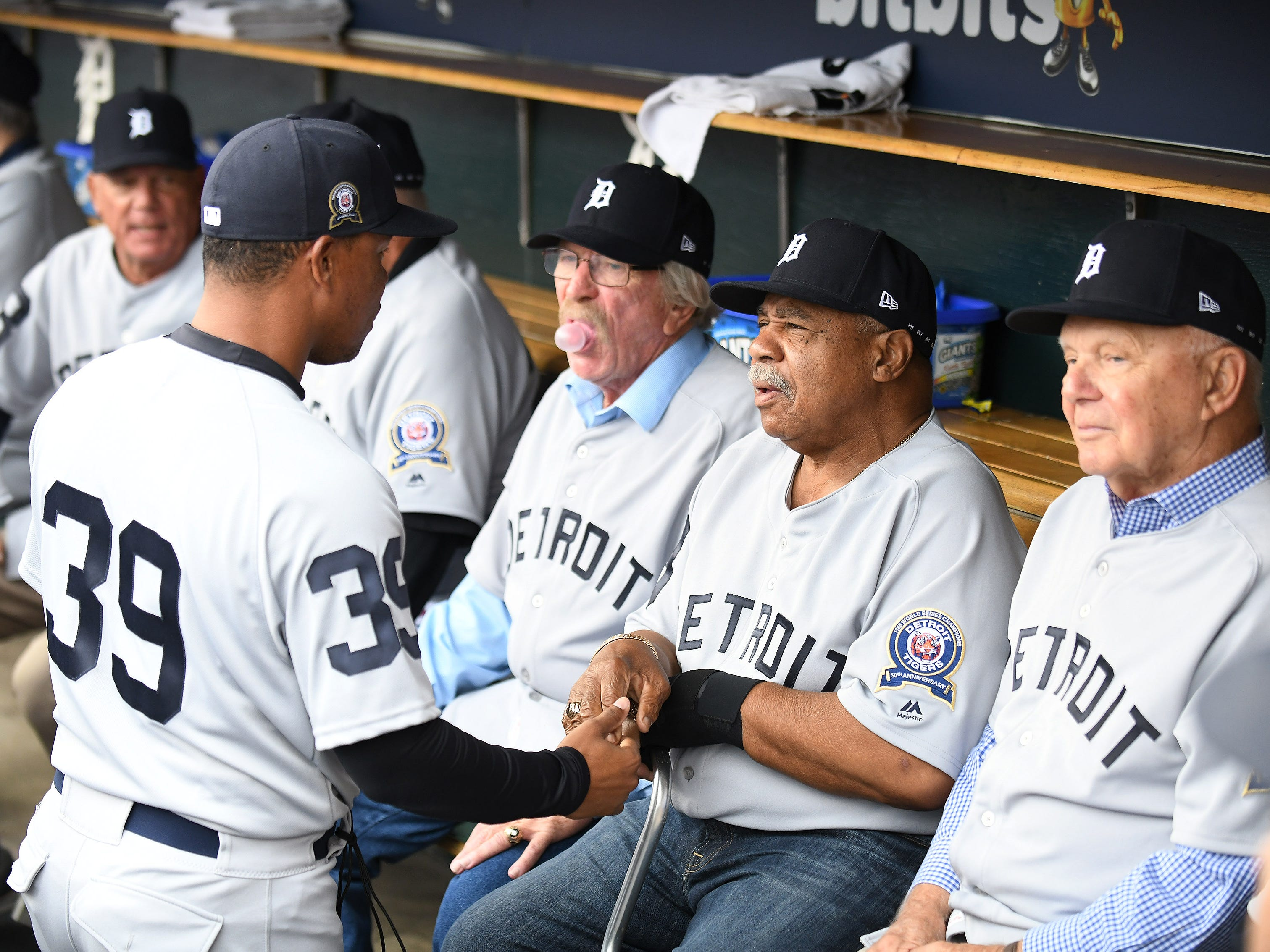 Willie Horton, second from right, talks with Tigers first-base coach Ramon Santiago during the ceremony. At far right is Dick Tracewski, and center blowing bubble is Tommy Matchick.