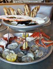 In the mood for deluxe seafood? Lure's seafood tower presents a cold platter with chilled lobster, snow crab, shrimp, and oysters; and a hot topper with mussels, clams and shrimp in garlic butter, split king crab, and baguette.