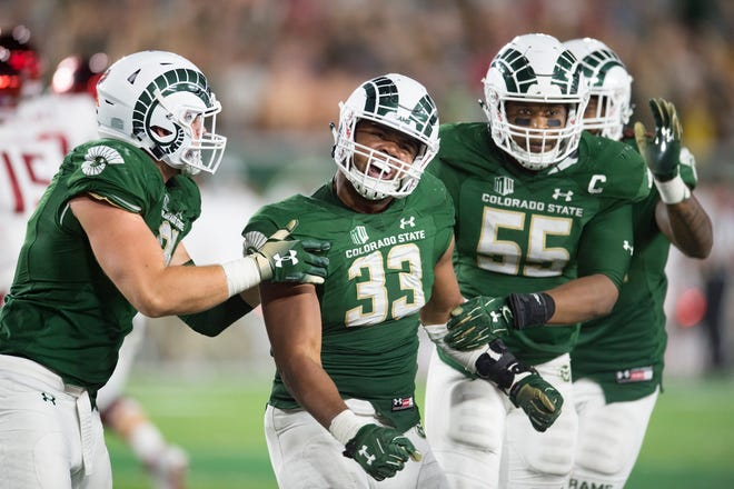CSU defensive end Emmanuel Jones (33) is an emerging star for the Rams after being lightly recruited out of high school.