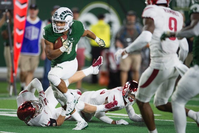 CSU running back Izzy Matthews breaks away from the Arkansas defense while running for a short gain during Saturday night's game at Canvas Stadium. The Rams rallied from 18 points down for a 33-27 victory.