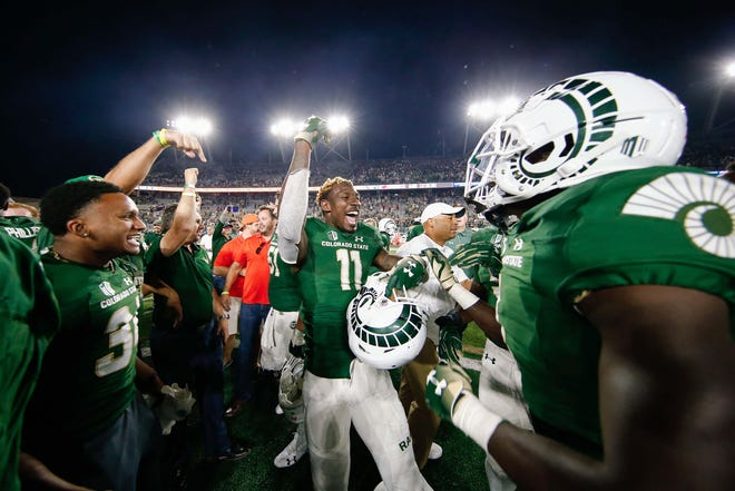 Colorado State Rams wide receiver Preston Williams (11) celebrates with teammates after the game against the Arkansas Razorbacks at Canvas Stadium.