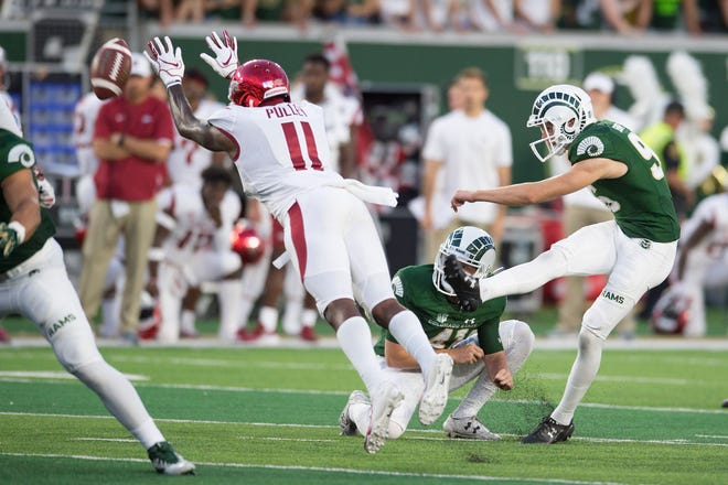 CSU kicker Wyatt Bryan kicks a field goal while Razorbacks cornerback Ryan Pulley leaps for the ball as CSU takes on Arkansas at Canvas Stadium on Saturday, September 8, 2018.