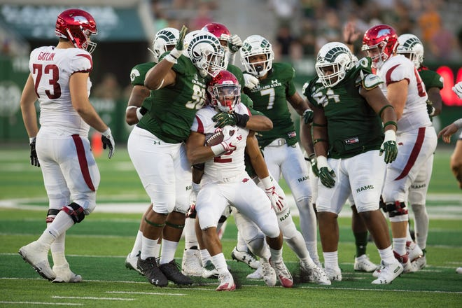 CSU defenders push Arkansas running back Chase Hayden back for a loss during last Saturday's game at Canvas Stadium. The Rams won 34-27 in the second of three straight non-conference games they're playing this year against schools from Power 5 conferences.