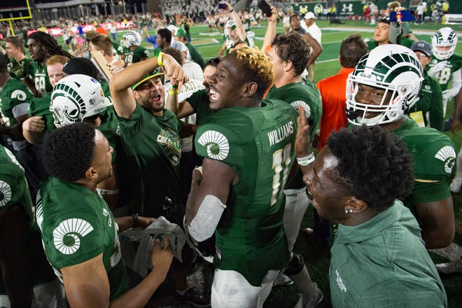 CSU receiver Preston Williams celebrates with his teammates after making several key plays for the Rams in a 34-27 win Saturday night over Arkansas at Canvas Stadium.