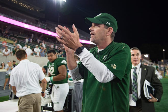 Coach Mike Bobo thanks fans after his CSU football team's 35-27 win over Arkansas on Sept. 8 at Canvas Stadium. Bobo believes a lack of leadership, among players and from the coach himself because of health issues that force him to miss part of fall camp, played a key role in the Rams' disappointing 3-9 season last fall.