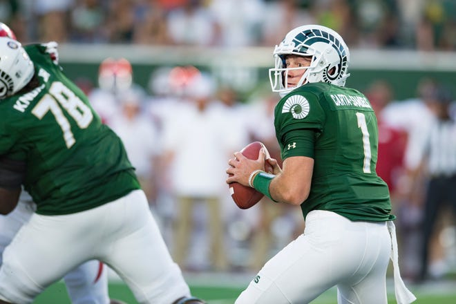 CSU quarterback K.J. Carta-Samuels looks for an open Rams receiver as CSU takes on Arkansas at Canvas Stadium on Saturday, September 8, 2018.