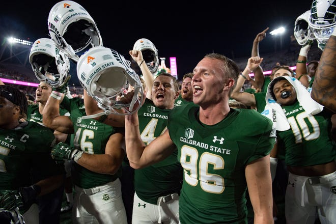 CSU kicker Wyatt Bryan celebrates with the Rams after a 34-27 win over Arkansas at Canvas Stadium on Saturday, September 8, 2018. Bryan scored four field goals in the game.