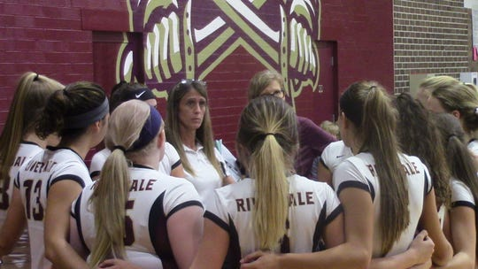 Riverdale volleyball coach Roni Hipp (center) has had five 20-win seasons for the Raiders after leaving Southeastern Louisiana as the program's leader in wins with 226.
