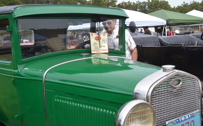 A man looks over the interior of a 1931 Ford at the 2017 Oconto Fly-in, Car & Tractor show. This year's show is expected to attract more than the 275 exhibited this year.