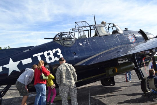 A family checks out the interior of a TBM  Avenger at the 2013 Oconto Fly-in, Car & Tractor Show. A TBM is scheduled to be at the 2018 event on Saturday, Sept. 15.