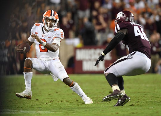 Clemson quarterback Kelly Bryant (2) tries to elude Texas A&M defensive lineman Landis Durham (46) during the 4th quarter at Texas A&M's Kyle Field in College Station, TX Saturday, September 8, 2018.