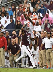 Clemson wide receiver Tee Higgins (5) catches a pass over Texas A&M defensive back Charles Oliver (21) during the 2nd quarter at Texas A&M's Kyle Field in College Station, TX Saturday, September 8, 2018. Higgins scored on the play.