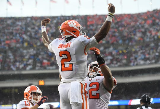 Clemson quarterback Kelly Bryant (2) celebrates with defensive lineman Christian Wilkins (42) after scoreing against Texas A&M during the 1st quarter at Texas A&M's Kyle Field in College Station, TX Saturday, September 8, 2018.