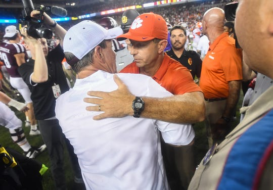 Clemson head coach Dabo Swinney hugs Texas A&M head coach Jimbo Fisher after the Tigers 28-26 win at Texas A&M's Kyle Field in College Station, TX Saturday, September 8, 2018.