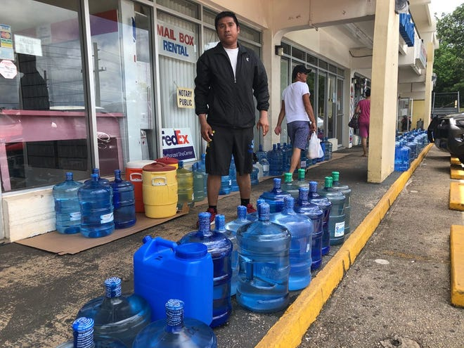 Residents get their water bottles filled ahead of Tropical Storm Mangkhut in Yigo on Sept. 9, 2018.
