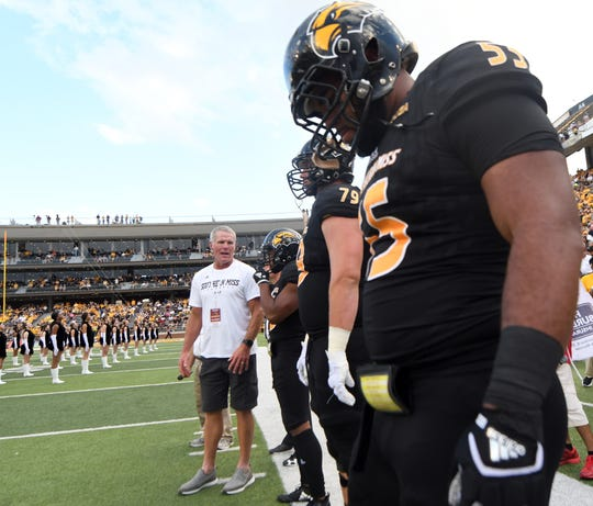 Southern Miss' Brett Favre speaks with players before the coin toss in a game against ULM on Saturday, September 8, 2018.