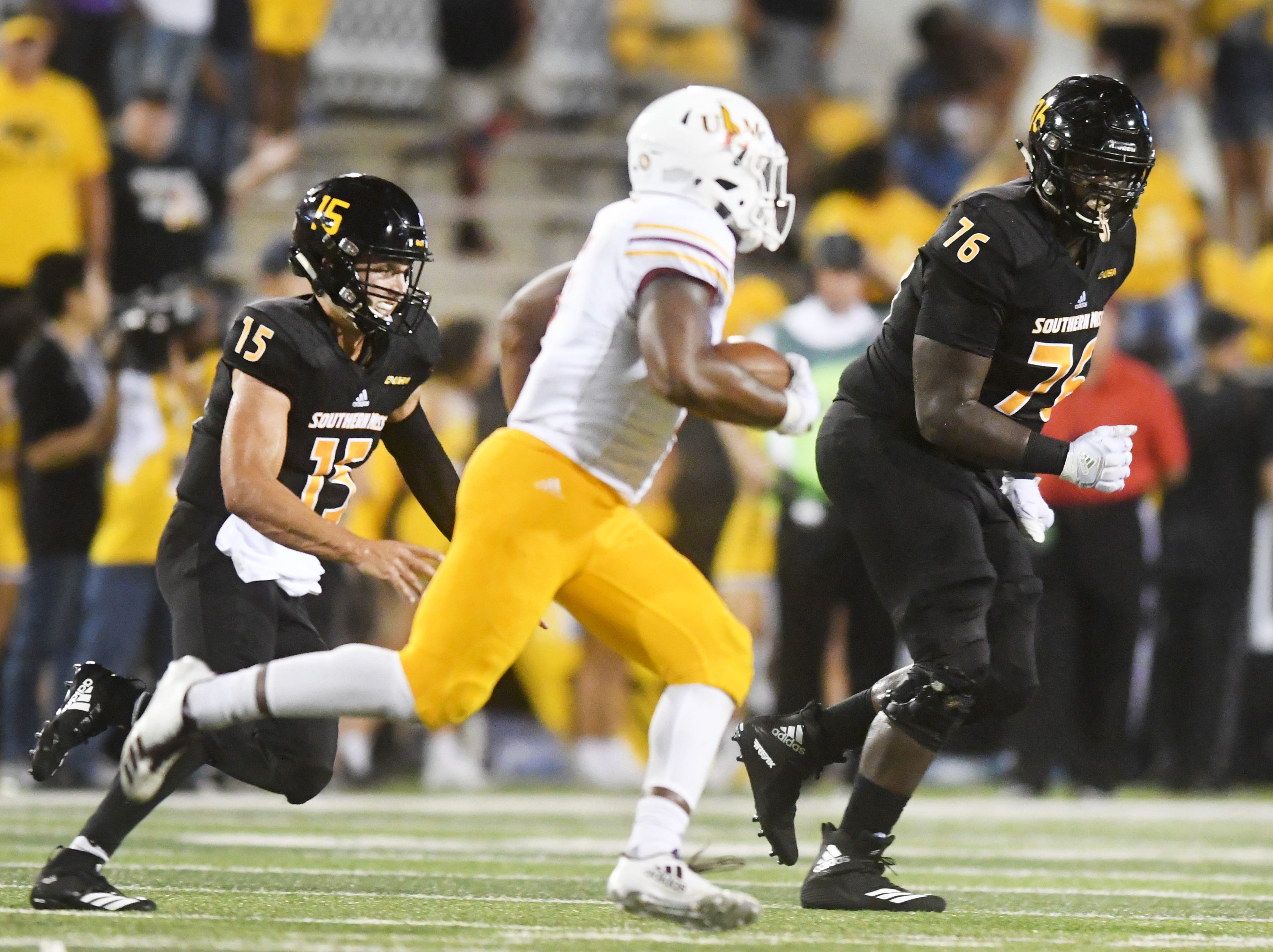 Southern Miss quarterback Jack Abraham, left, and offensive lineman Ty Pollard chase after ULM linebacker Cortez Sisco Jr. after an interception in M.M. Roberts Stadium on Saturday, September 8, 2018. The Eagles fall to the Warhawks, 20-21.