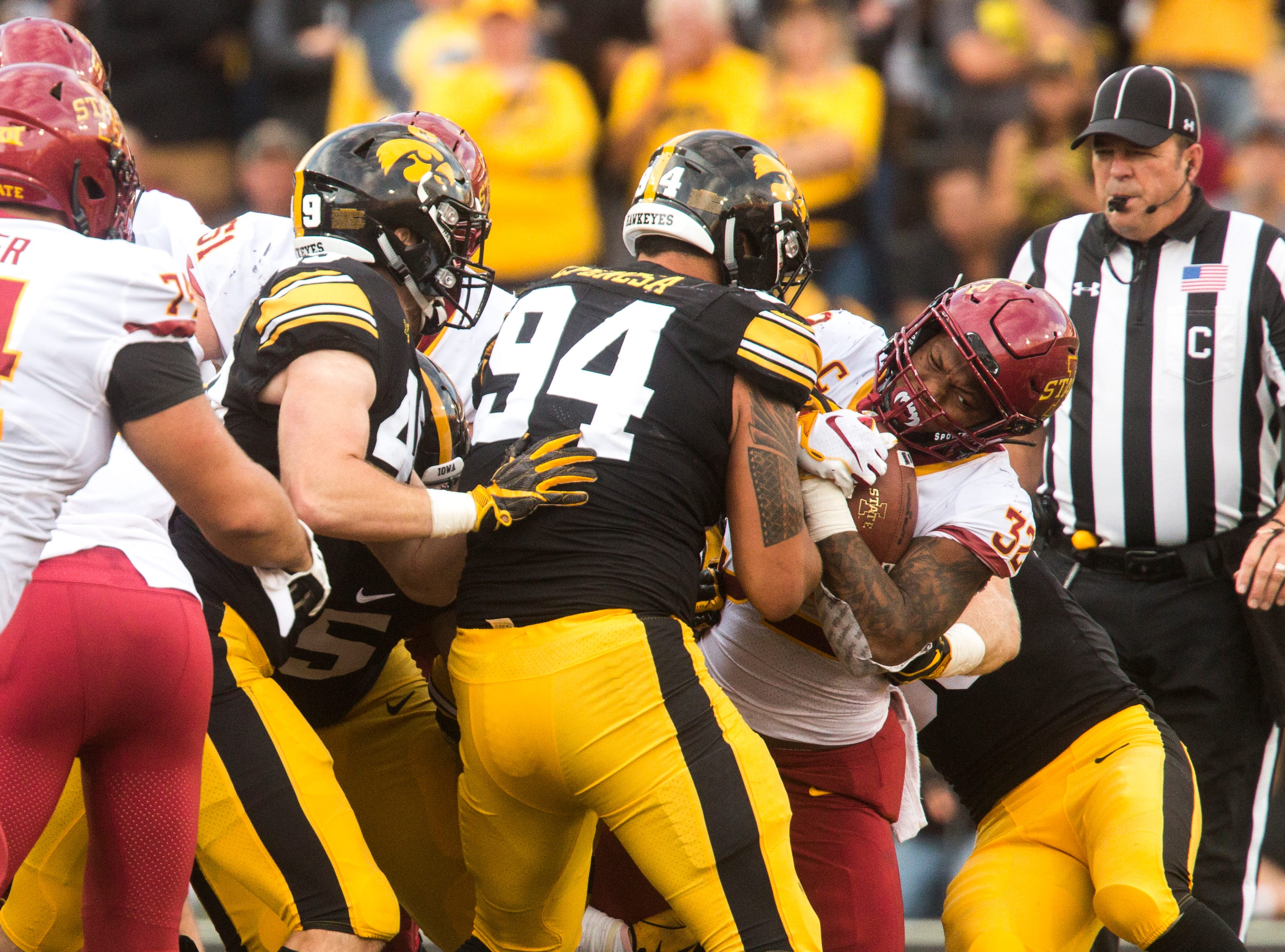 Iowa State running back David Montgomery (32) gets stopped by Iowa defensive end A.J. Epenesa (94) during the Cy-Hawk NCAA football game on Saturday, Sept. 8, 2018, at Kinnick Stadium in Iowa City.
