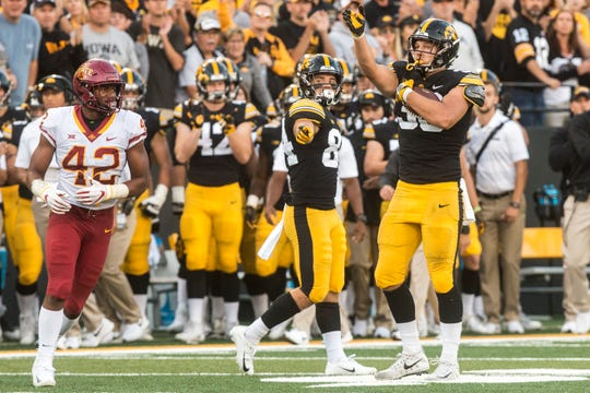 One of T.J. Hockenson's trademark moves was pointing downfield after making a clutch first-down catch. Here, he gestures during the Hawkeyes' 13-3 win against Iowa State on Sept. 9.