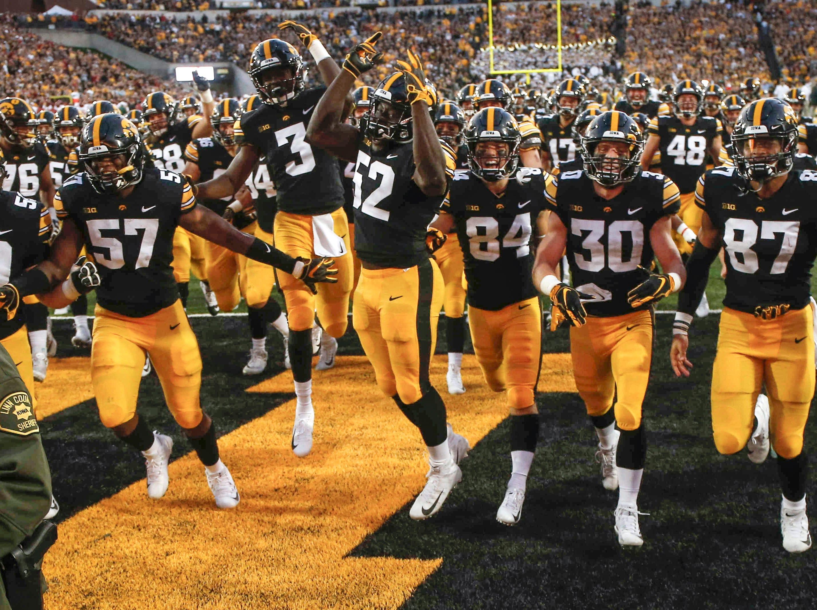 Members of the Iowa football team celebrate a 13-3 win over Iowa State on Saturday, Sept. 8 2018, at Kinnick Stadium in Iowa City.