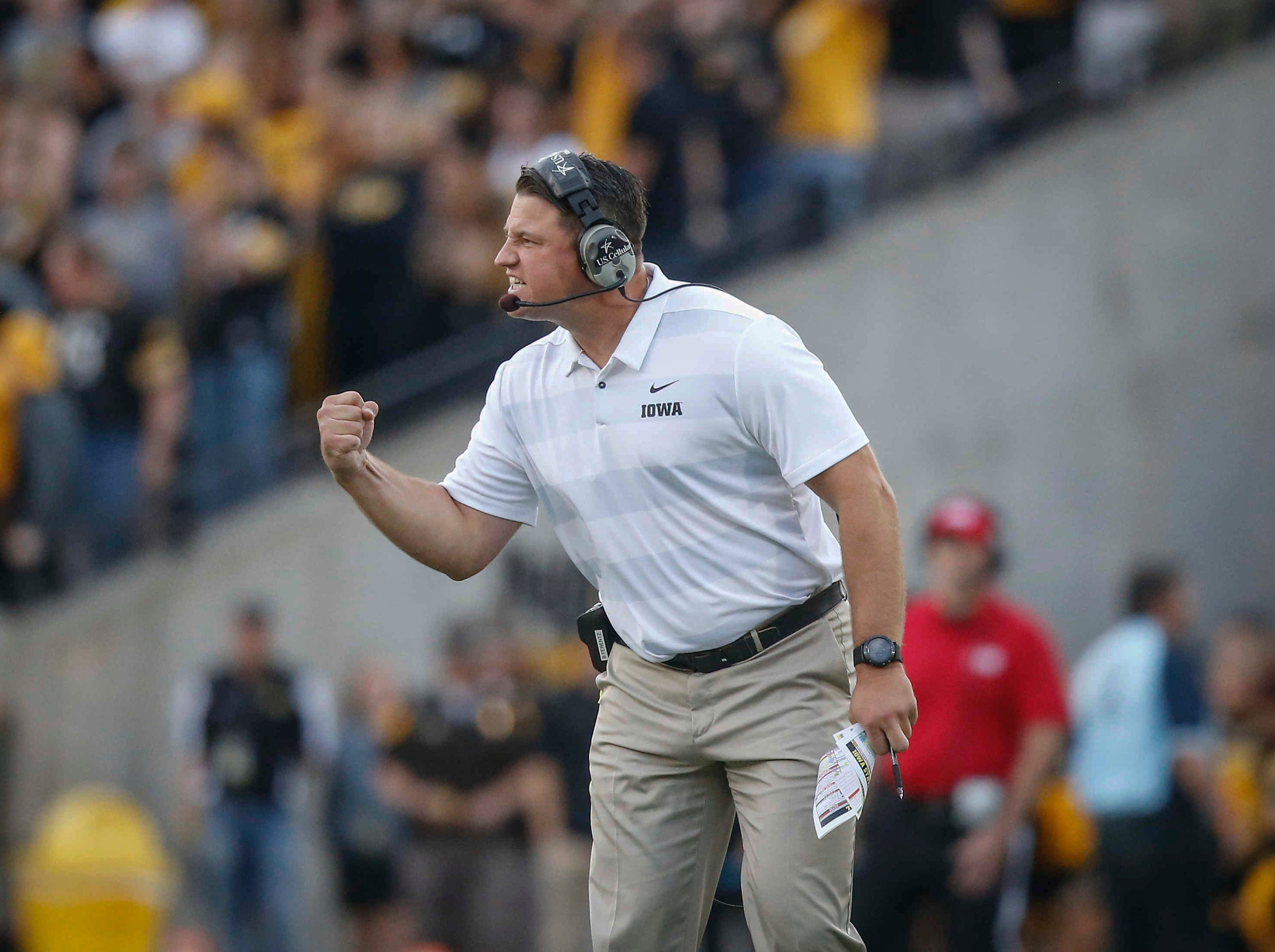 Iowa offensive coordinator Brian Ferentz pumps his fist as the Hawkeyes drive for a first down late against Iowa State on Saturday, Sept. 8, 2018, at Kinnick Stadium in Iowa City.