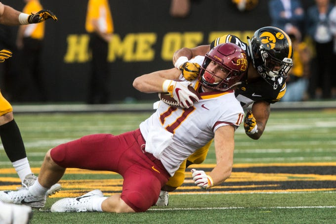 Iowa defensive back Amani Hooker (27) tackles Iowa State tight end Chase Allen (11) during the Cy-Hawk NCAA football game on Saturday, Sept. 8, 2018, at Kinnick Stadium in Iowa City.