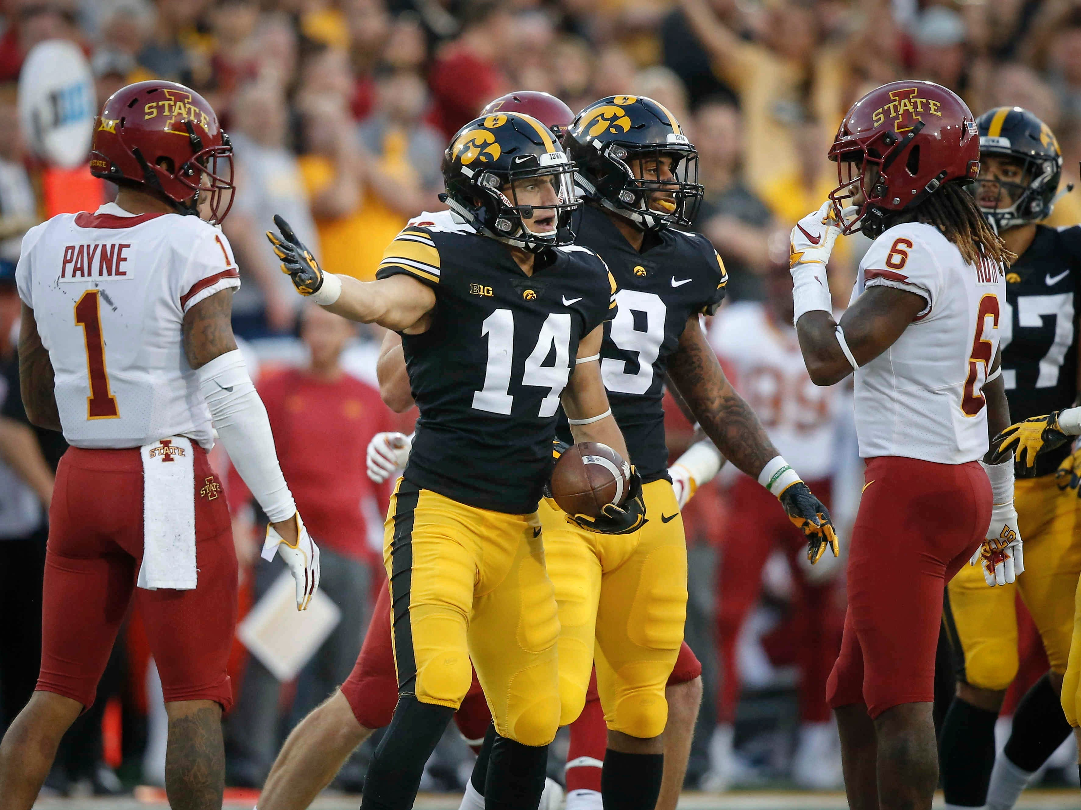 Iowa senior Kyle Groeneweg motions to an Iowa State player after being interfered with on a punt reception on Saturday, Sept. 9, 2018, at Kinnick Stadium in Iowa City.