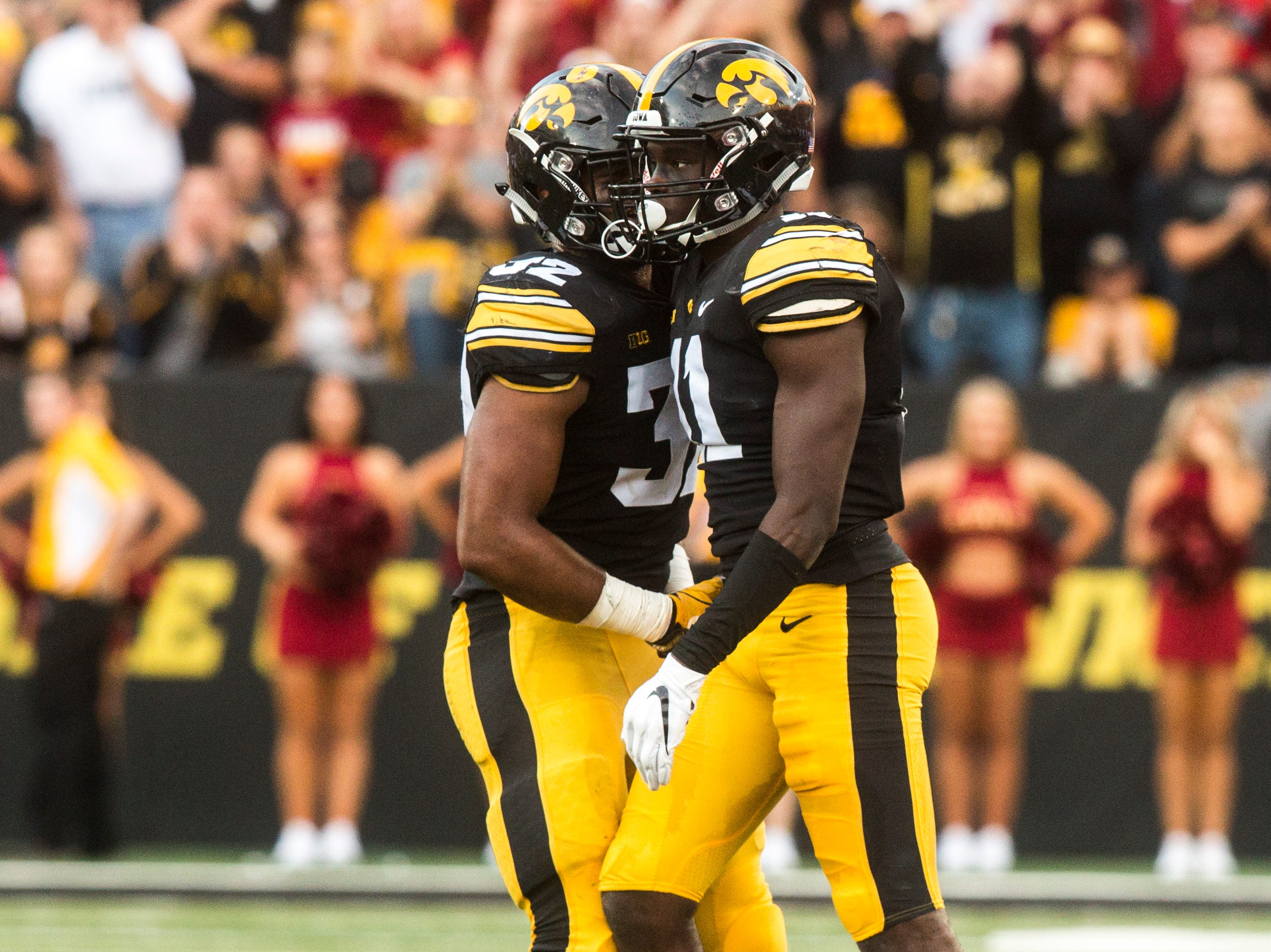 Iowa defensive back Michael Ojemudia (11) celebrates a stop with teammate Djimon Colbert (32) during the Cy-Hawk NCAA football game on Saturday, Sept. 8, 2018, at Kinnick Stadium in Iowa City.