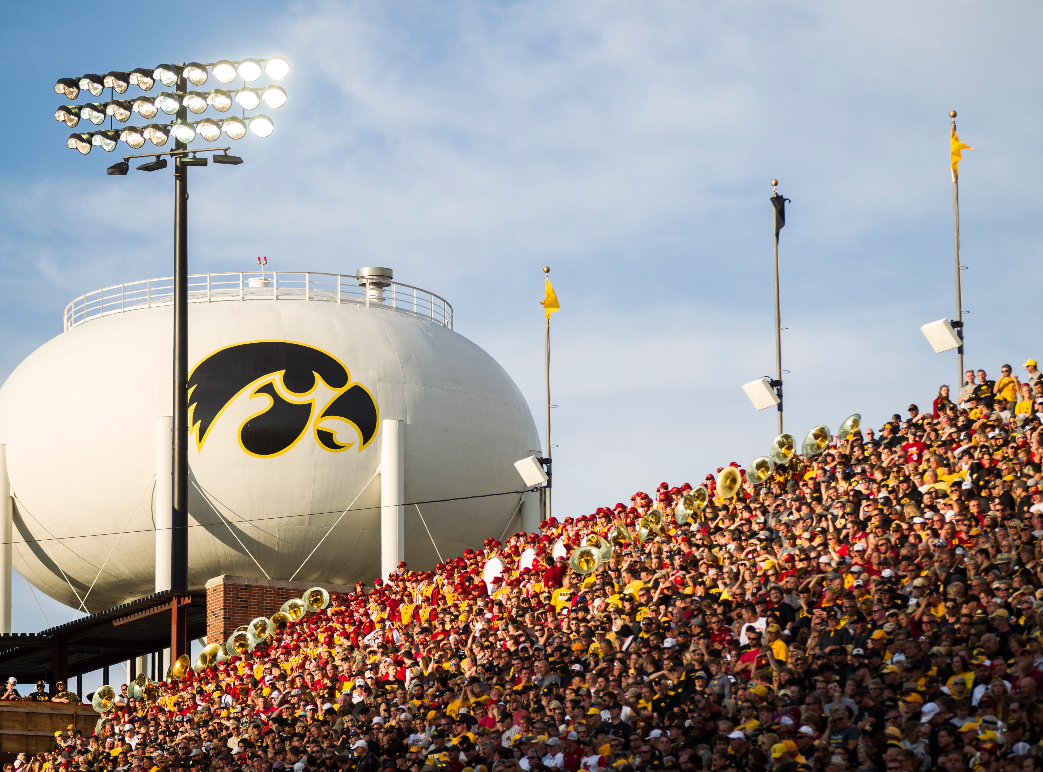 The sun sets past the recently painted Tigerhawk water tower during the Cy-Hawk NCAA football game on Saturday, Sept. 8, 2018, at Kinnick Stadium in Iowa City.