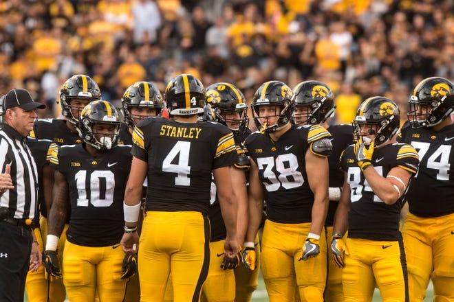 Iowa quarterback Nate Stanley (4) talks to teammates during the Cy-Hawk NCAA football game on Saturday, Sept. 8, 2018, at Kinnick Stadium in Iowa City.