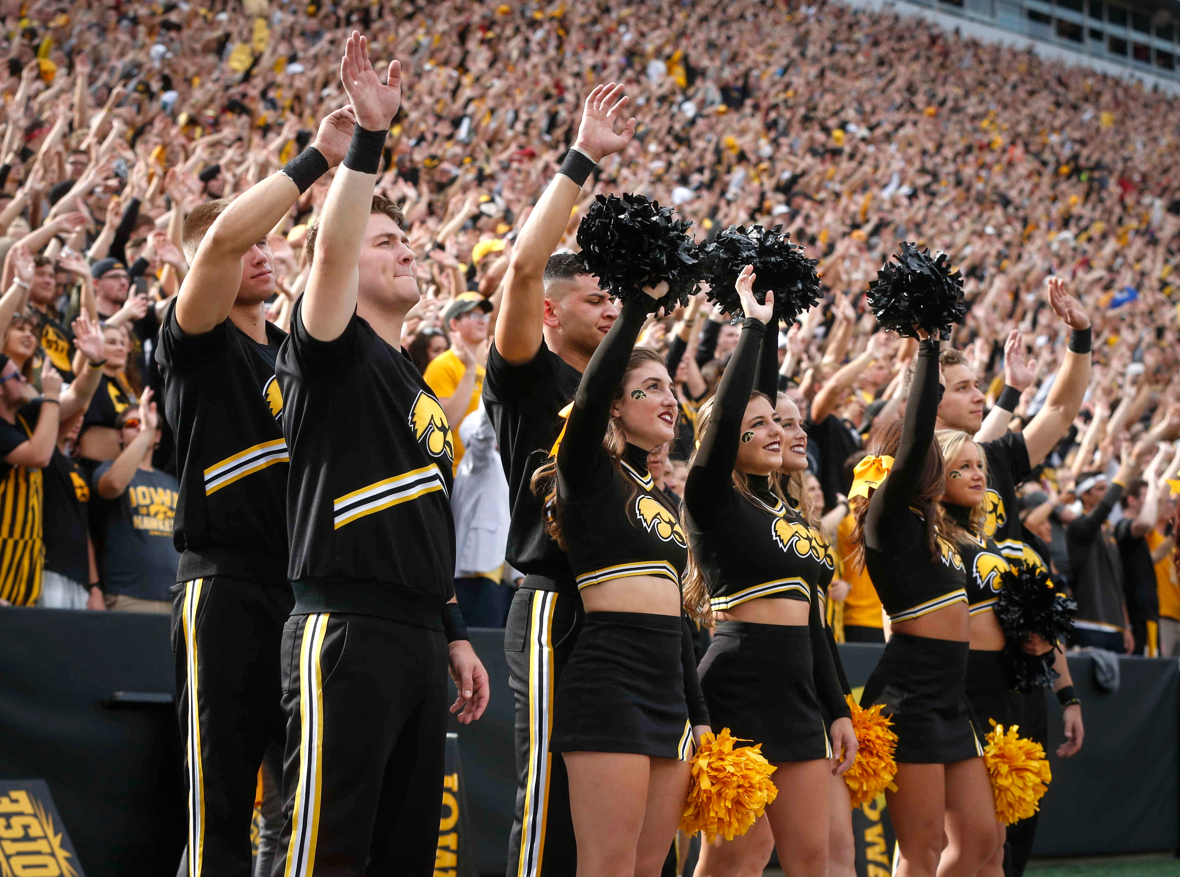 Iowa cheerleaders wave at the end of the first quarter against Iowa State on Saturday, Sept. 8, 2018, at Kinnick Stadium in Iowa City.