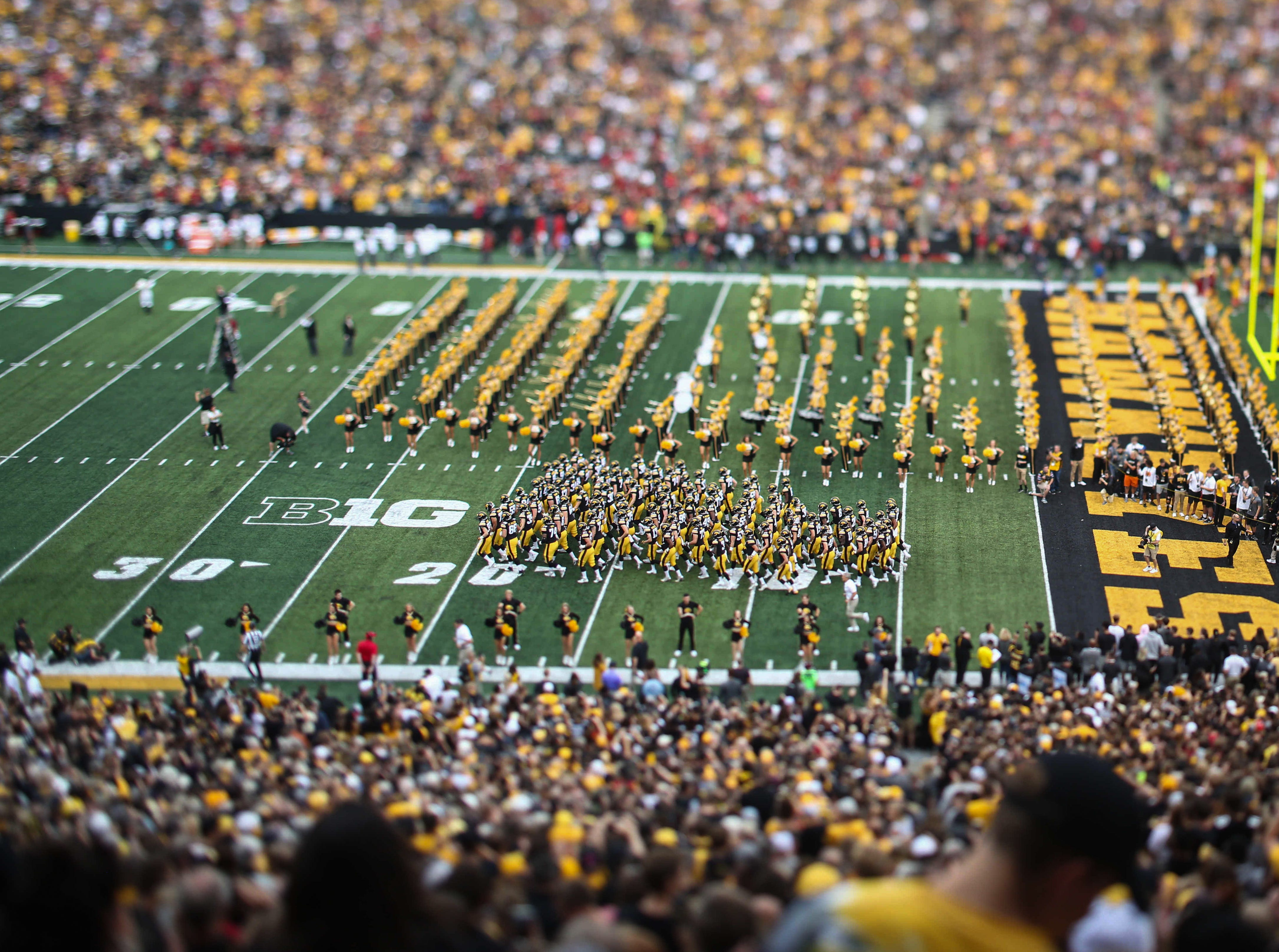 Members of the Iowa Hawkeyes football team take the field prior to kickoff against Iowa State on Saturday, Sept. 8 2018, at Kinnick Stadium in Iowa City.