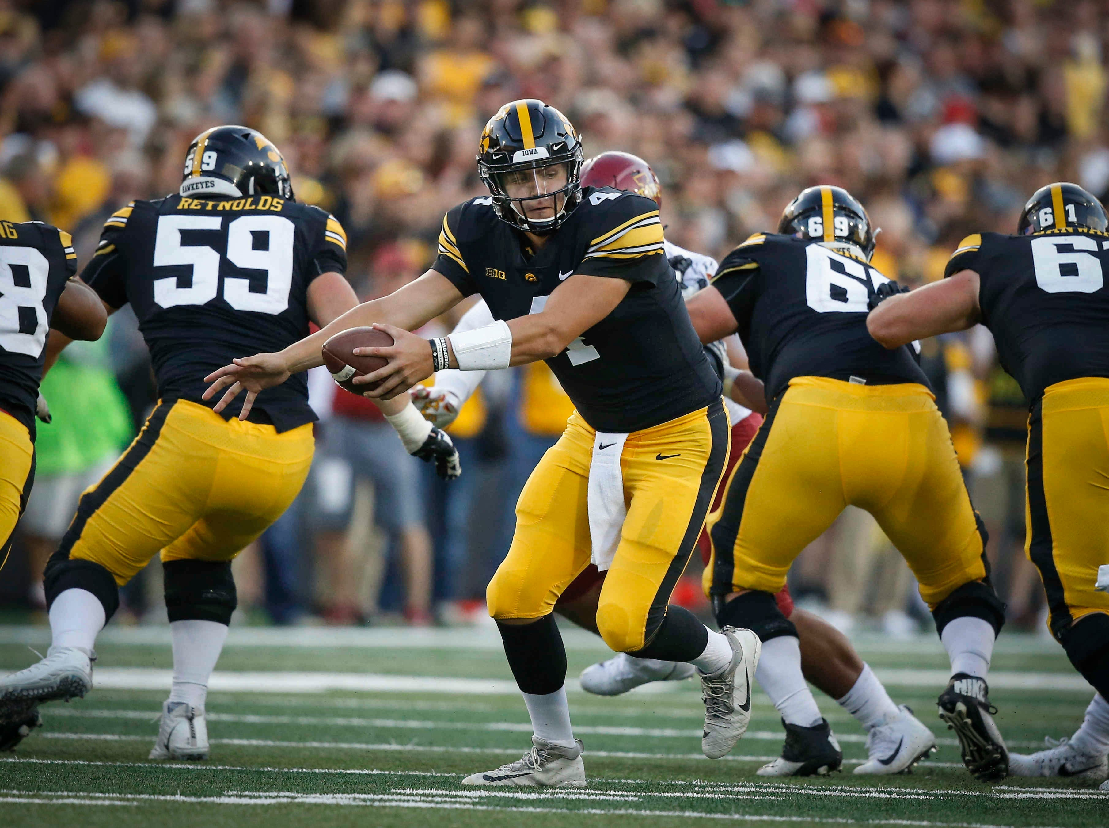 Iowa quarterback Nate Stanley hands the ball out to a running back against Iowa State on Saturday, Sept. 9, 2018, at Kinnick Stadium in Iowa City.