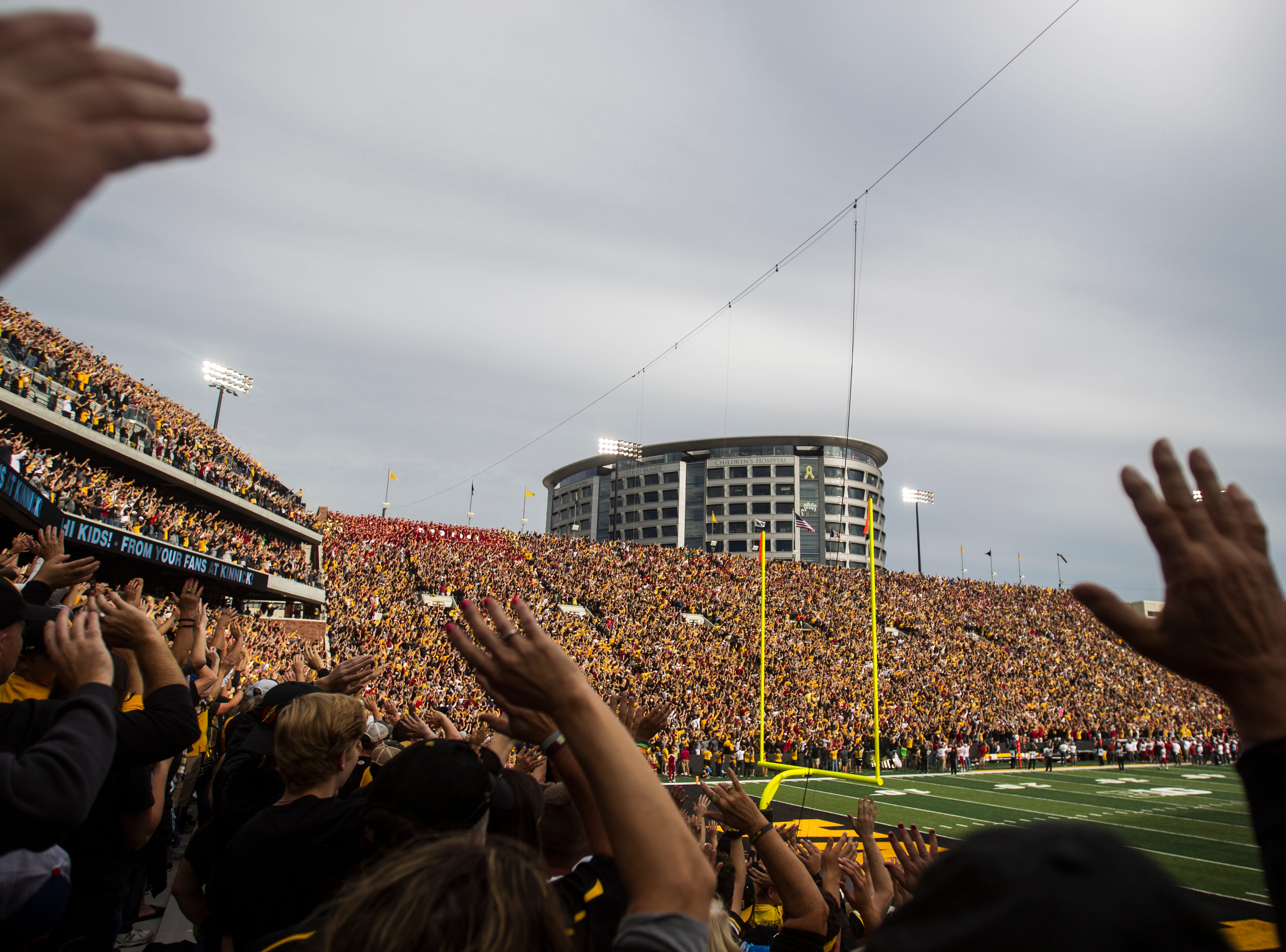Iowa fans wave to patients in the University Stead Family Children's Hospital after the first quarter during the Cy-Hawk NCAA football game on Saturday, Sept. 8, 2018, at Kinnick Stadium in Iowa City.