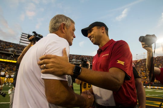 The coaches in the annual Cy-Hawk football game (Iowa's Kirk Ferentz on left and Iowa State's Matt Campbell on right) have no trouble maintaining their civility. Among the fans? It's often a different story. And much of it plays out on Twitter.