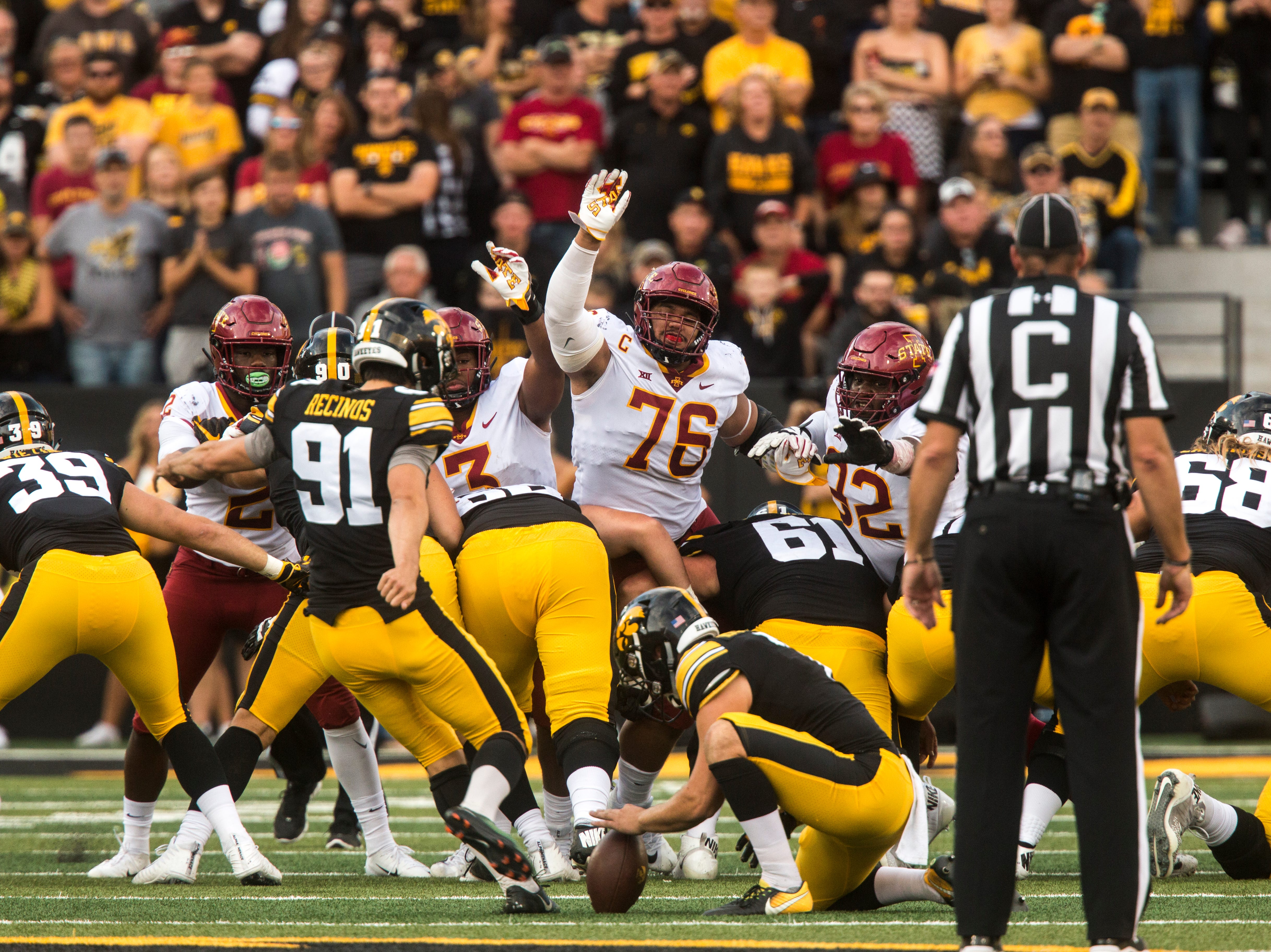 Iowa State defensive lineman Ray Lima (76) attempts to block a field goal from Iowa placekicker Miguel Recinos (91) during the Cy-Hawk NCAA football game on Saturday, Sept. 8, 2018, at Kinnick Stadium in Iowa City.