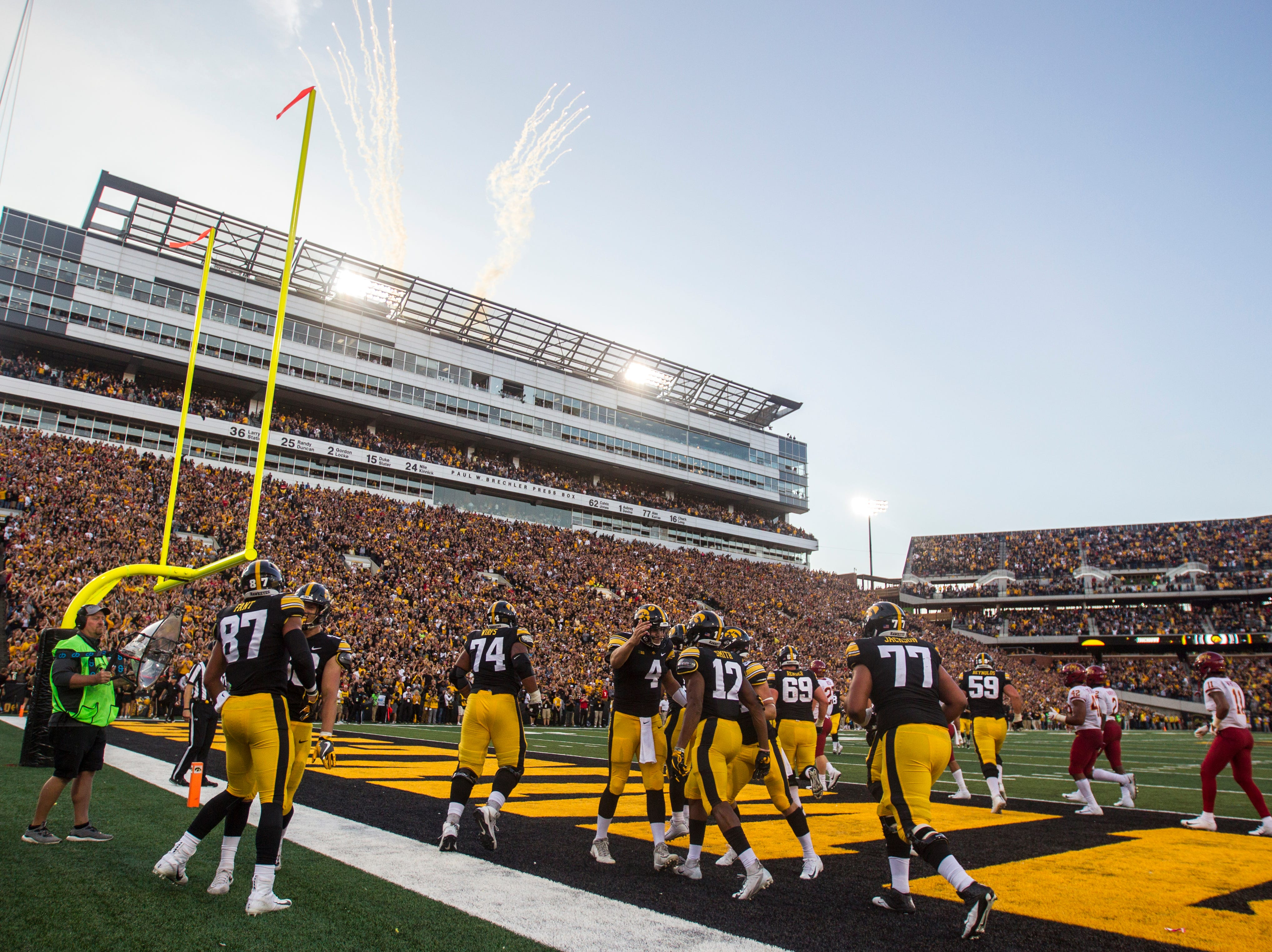 Iowa quarterback Nate Stanley (4) celebrates with teammates after a touchdown during the Cy-Hawk NCAA football game on Saturday, Sept. 8, 2018, at Kinnick Stadium in Iowa City.