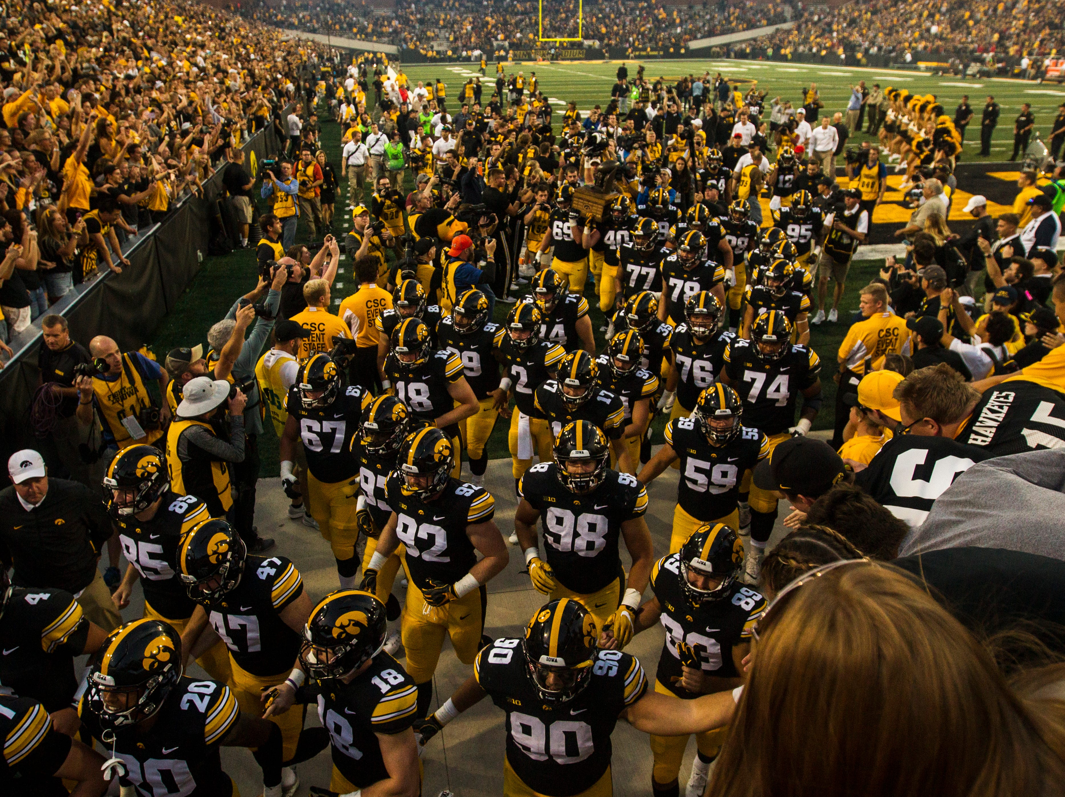 Members of the Iowa Hawkeyes run into their tunnel after the Cy-Hawk NCAA football game on Saturday, Sept. 8, 2018, at Kinnick Stadium in Iowa City. The Hawkeyes defeated the Cyclones, 13-3.