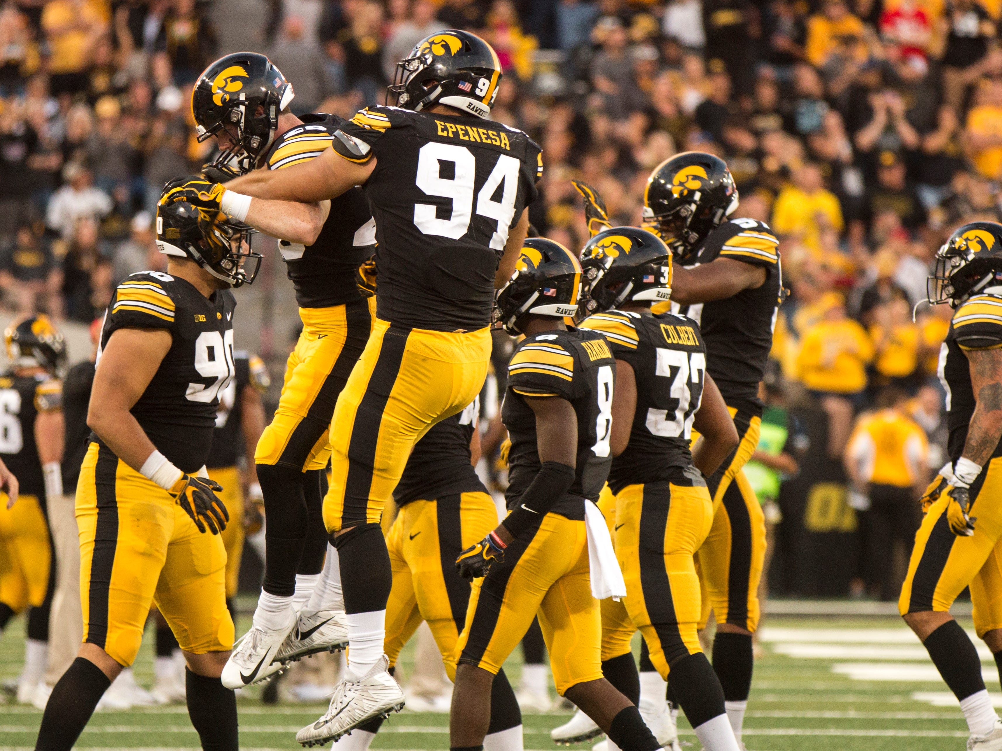 Iowa defensive end A.J. Epenesa (94) celebrates with teammates after forcing a fumble during the Cy-Hawk NCAA football game on Saturday, Sept. 8, 2018, at Kinnick Stadium in Iowa City.
