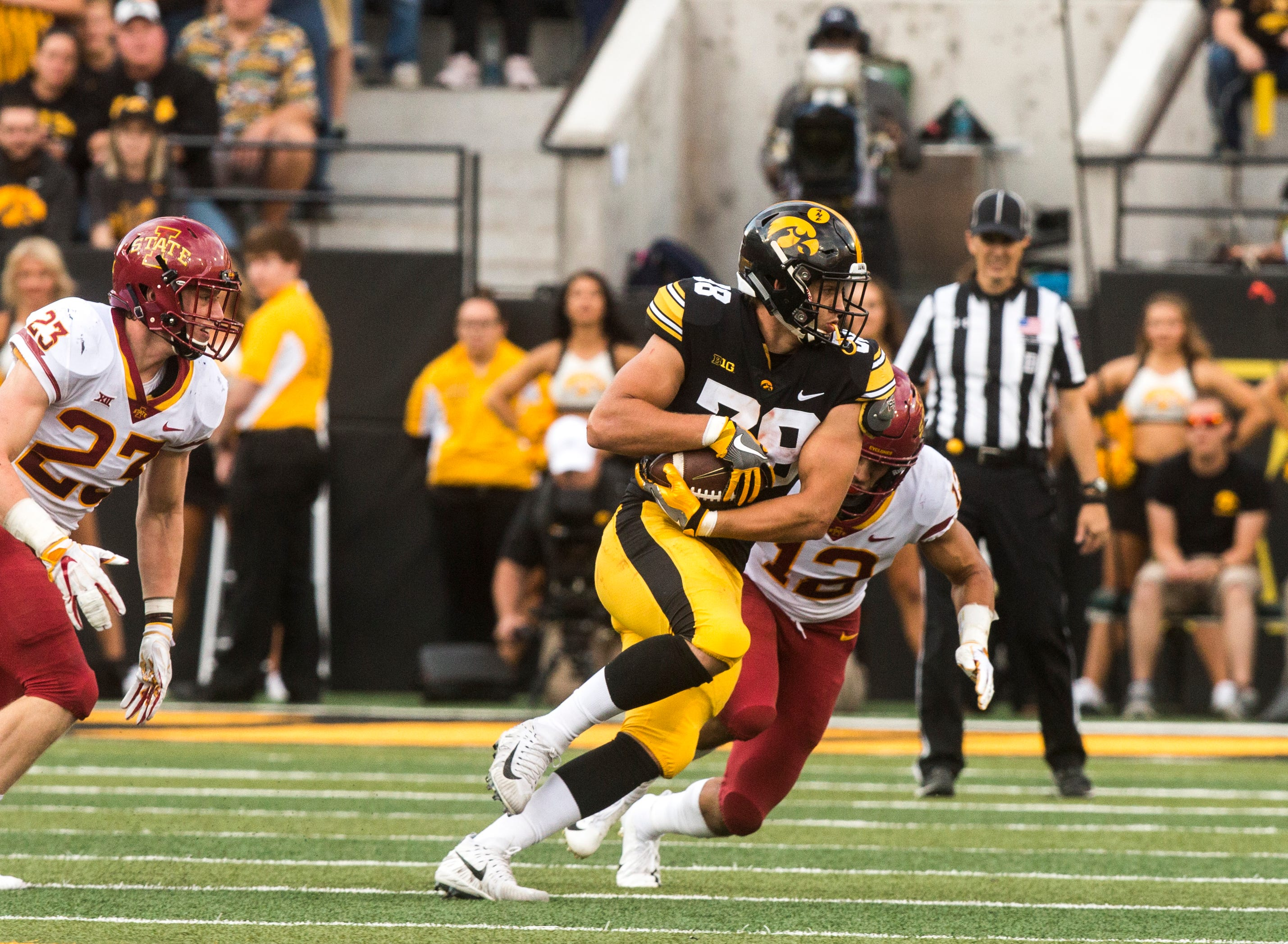 Iowa tight end T.J. Hockenson (38) gets tackled by Iowa State defensive back Greg Eisworth (12) during the Cy-Hawk NCAA football game on Saturday, Sept. 8, 2018, at Kinnick Stadium in Iowa City.