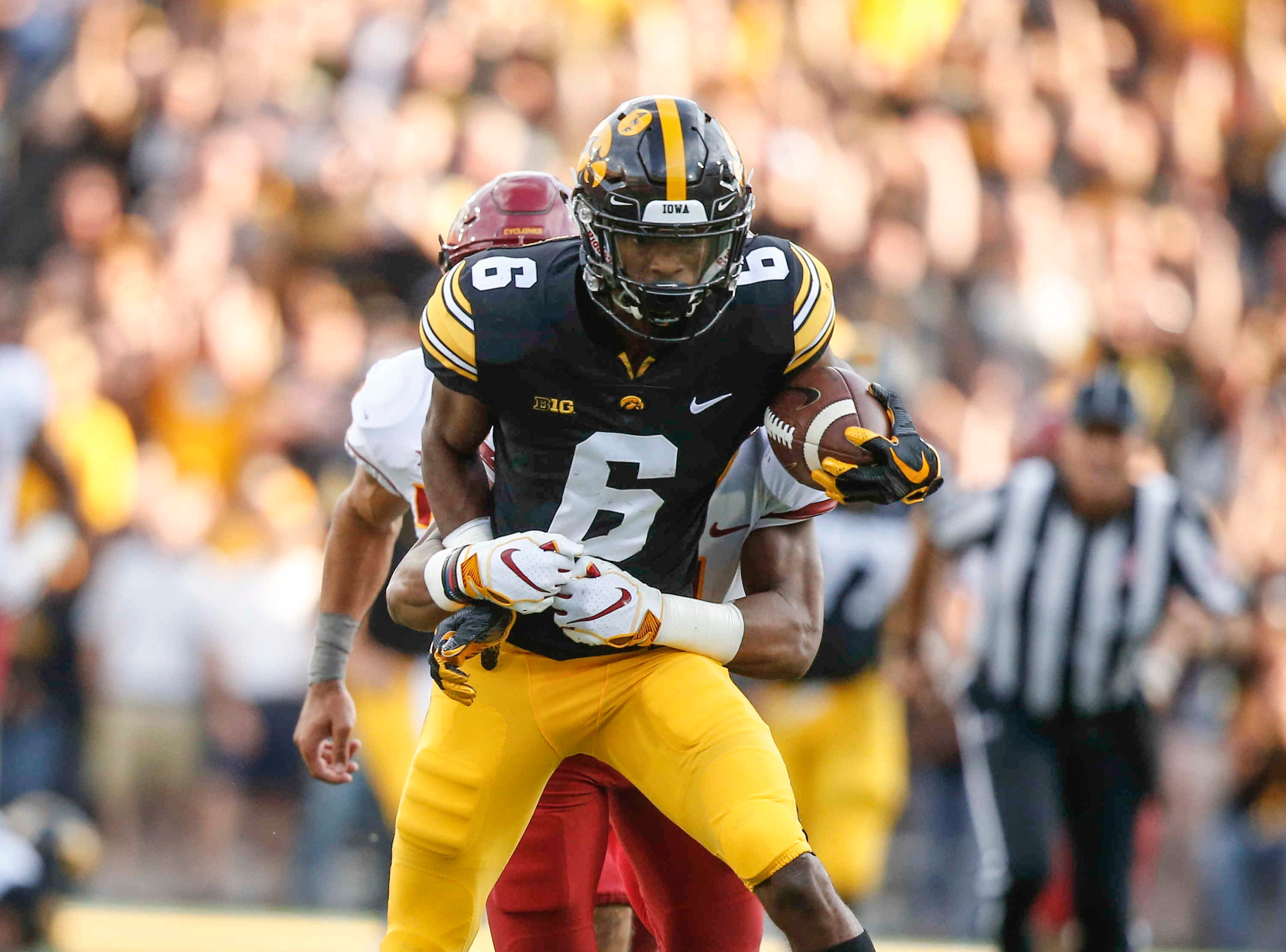 Iowa receiver Ihmir Smith-Marsette is caught after pulling in a reception against Iowa State on Saturday, Sept. 8, 2018, at Kinnick Stadium in Iowa City.