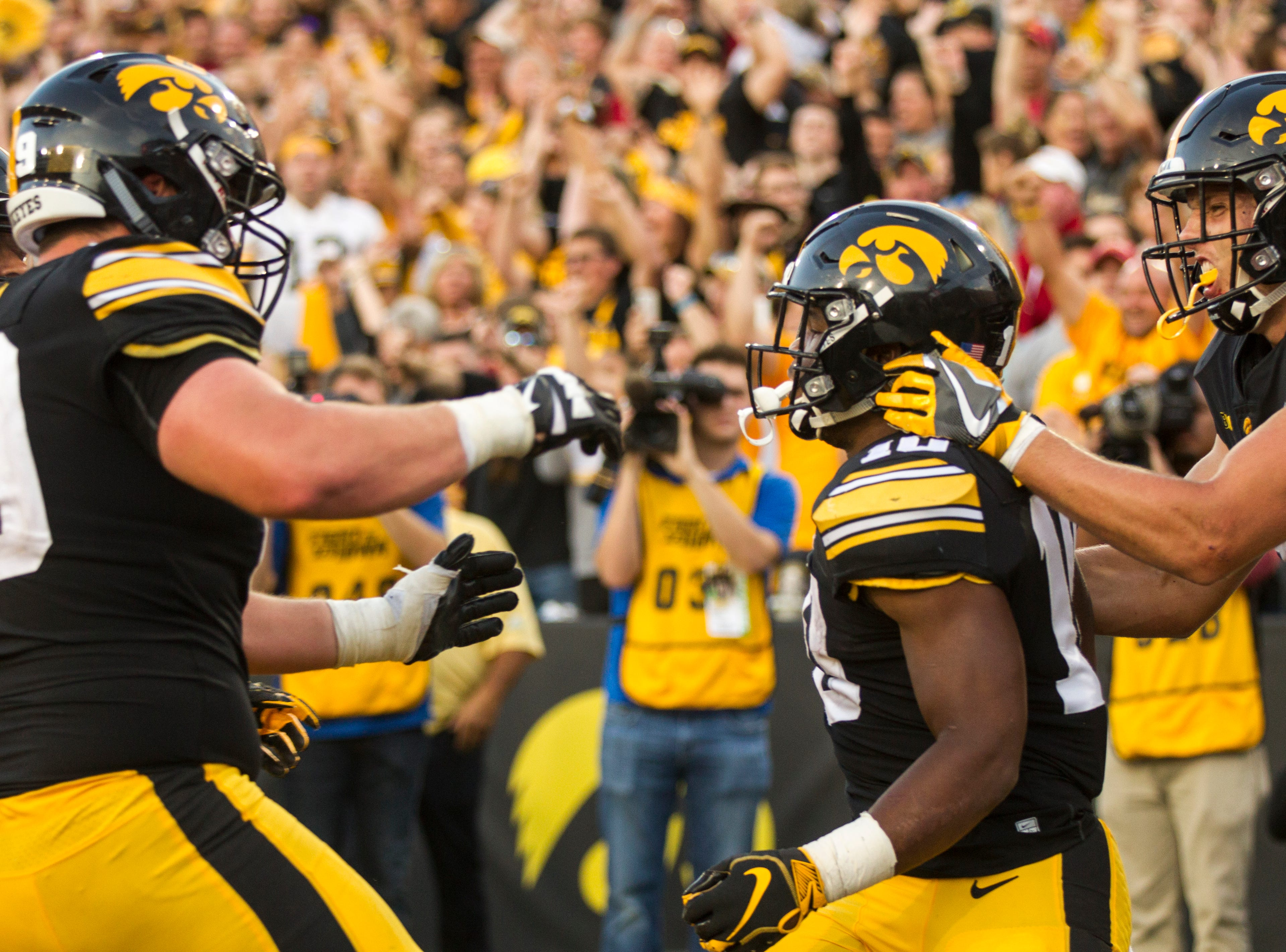 Iowa running back Mekhi Sargent (10) celebrates after scoring a touchdown during the Cy-Hawk NCAA football game on Saturday, Sept. 8, 2018, at Kinnick Stadium in Iowa City.