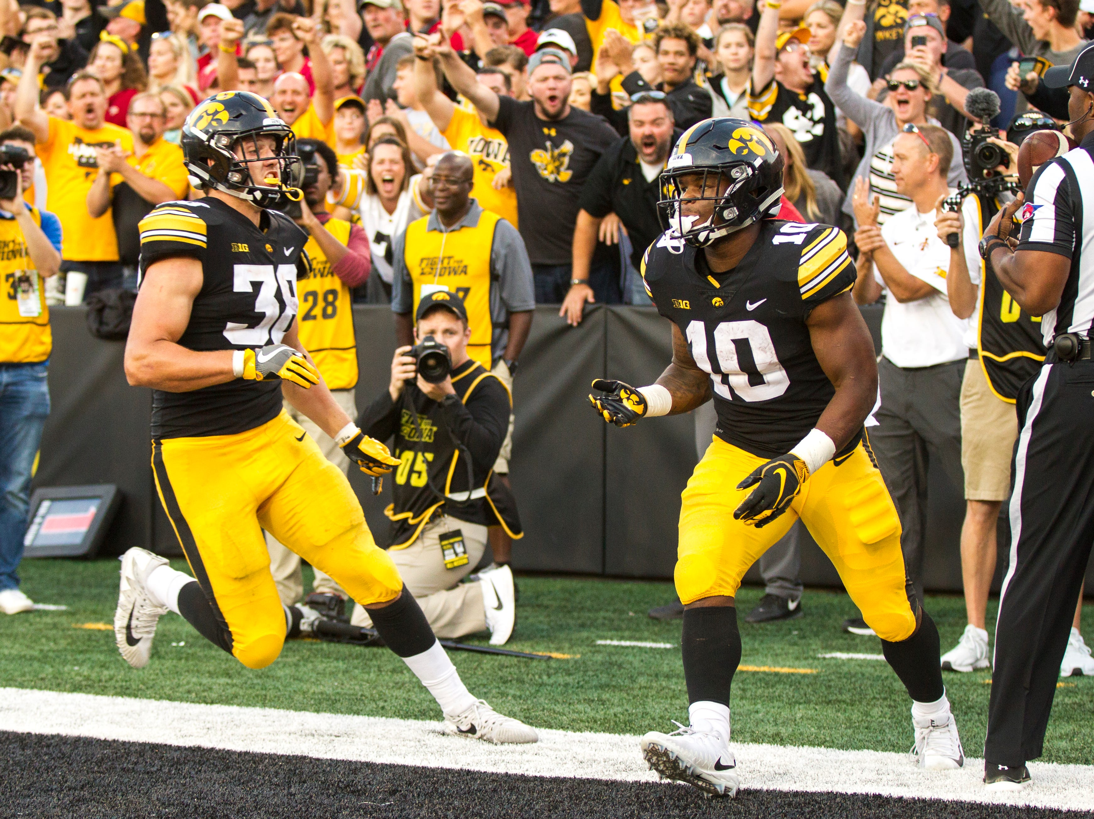 Iowa running back Mekhi Sargent (10) scores a touchdown during the Cy-Hawk NCAA football game on Saturday, Sept. 8, 2018, at Kinnick Stadium in Iowa City.