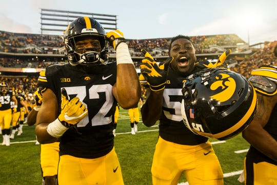 Amani Jones (right, along with Djimon Colbert) is shown celebrating Iowa's Sept. 8, 2018, victory against Iowa State. Jones was pulled in the first quarter of his only career start.