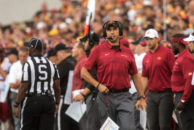 Iowa State head coach Matt Campbell talks into his headset while walking on the sideline during the Cy-Hawk NCAA football game on Saturday, Sept. 8, 2018, at Kinnick Stadium in Iowa City.