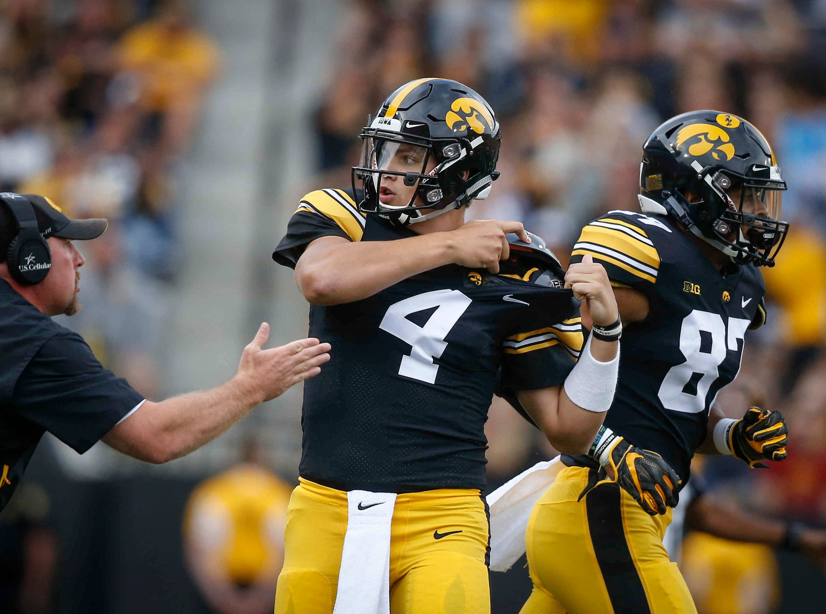 Iowa quarterback Nate Stanley adjusts his shoulder pads after scrambling for a first down run against Iowa State on Saturday, Sept. 8, 2018, at Kinnick Stadium in Iowa City.