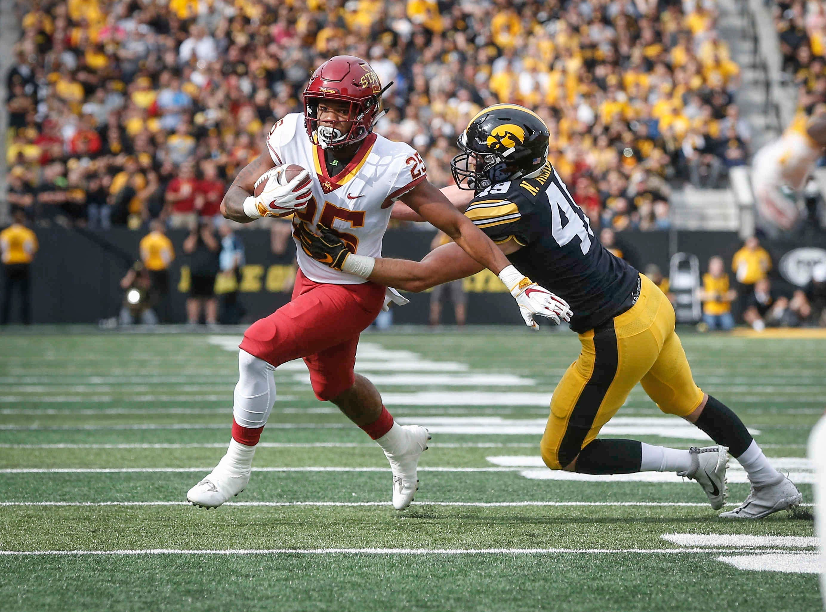 Iowa State running back Sheldon Croney escapes the reach of Iowa linebacker Nick Niemann on Saturday, Sept. 8, 2018, at Kinnick Stadium in Iowa City.