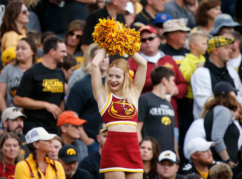 An Iowa State cheerleader performs a routine against Iowa on Saturday, Sept. 8, 2018, at Kinnick Stadium in Iowa City.