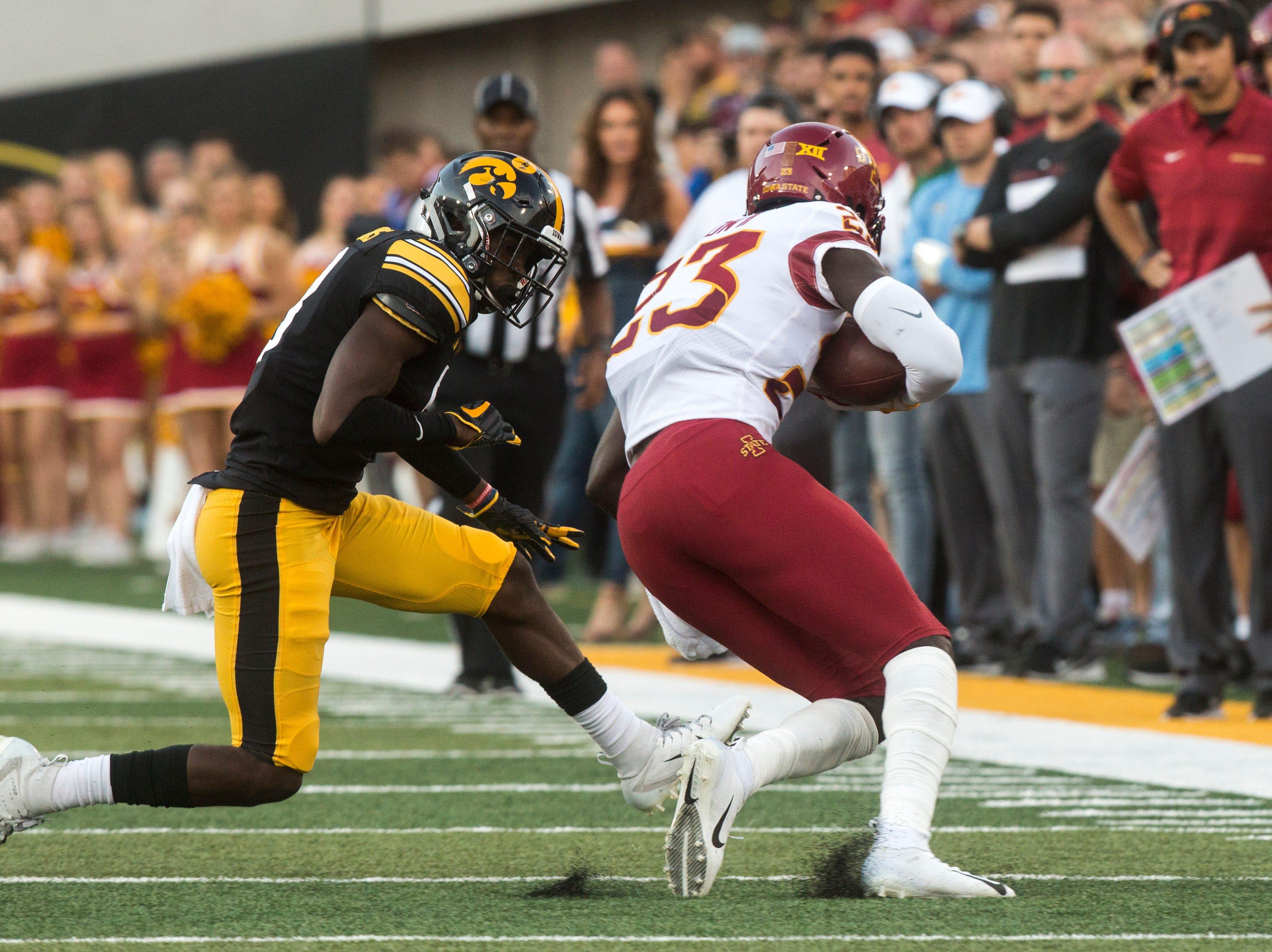 Iowa defensive back Matt Hankins (8) tackles Iowa State wide receiver Matthew Eaton (23) during the Cy-Hawk NCAA football game on Saturday, Sept. 8, 2018, at Kinnick Stadium in Iowa City.