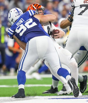 Indianapolis Colts defensive end Margus Hunt (92) sacks Cincinnati Bengals quarterback Andy Dalton (14) at Lucas Oil Stadium on Sunday, Sept. 9, 2018.